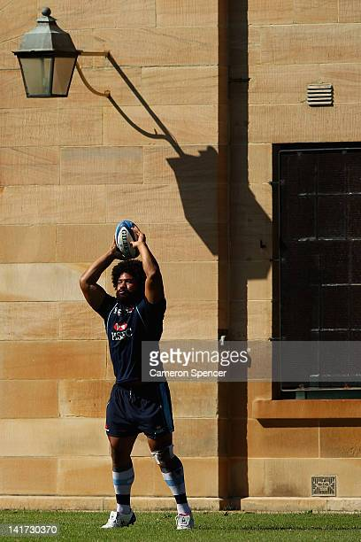 Tatafu PolotaNau of the Waratahs throws a lineout ball during a Waratahs Super Rugby training session at Victoria Barracks on March 23 2012 in Sydney...