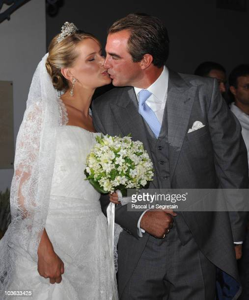 Tatania Blatnik and Prince Nikolaos of Greece kiss each other outside the Cathedral of Ayios Nikolaos after getting married on August 25 2010 in...