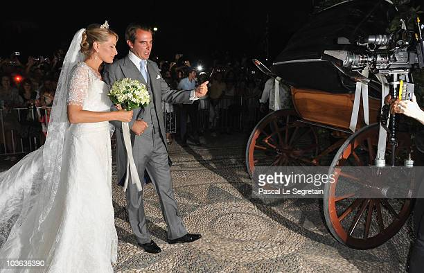Tatania Blatnik and Prince Nikolaos of Greece walk outside the Cathedral of Ayios Nikolaos after getting married on August 25 2010 in Spetses Greece...