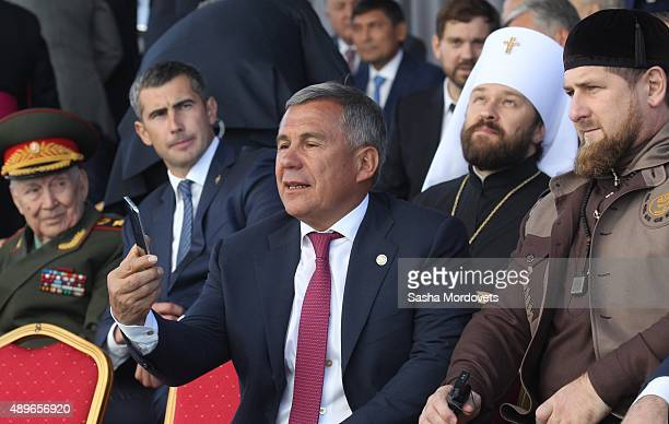 Tatarstan President Rustam Minnikhanov takes a selfie next to Chechen President Ramzan Kadyrov attend an opening ceremony for the newly restored...
