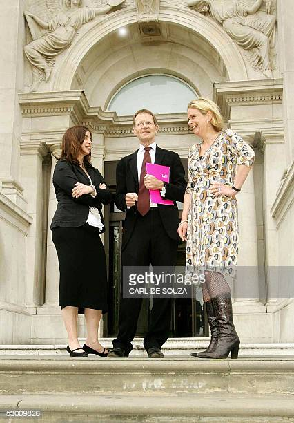 Tate Director Nicholas Serota and judges Kate Bush and Louisa Buck pose for pictures outside the Tate Britain after the announcement for the...
