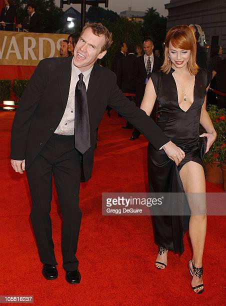 Tate Donovan and Melinda Clarke during The 30th Annual People's Choice Awards Arrivals at Pasadena Civic Auditorium in Pasadena California United...