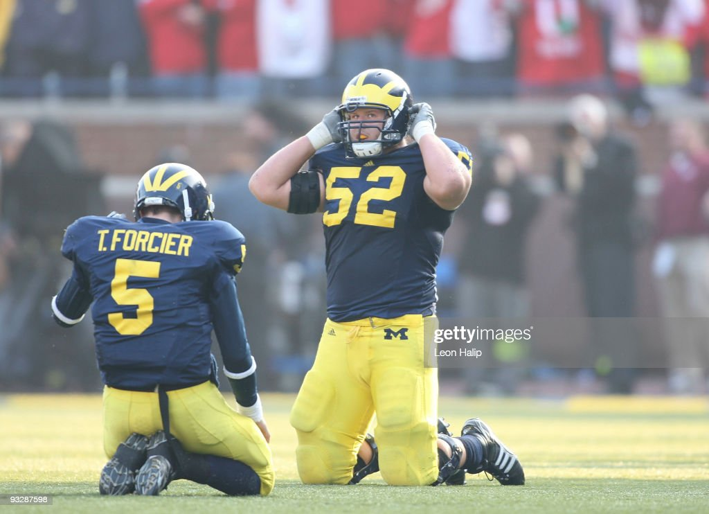 Tate Forcier #5 and Kevin Leach #52 of the University of Michigan react after Forcier's fourth interception of the game late in the fourth quarter. Ohio State defeated Michigan 21-10 at Michigan Stadium on November 21, 2009 in Ann Arbor, Michigan.