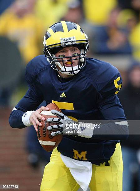 Tate Forcier of the Michigan Wolverines roles out to pass in the second quarter at Michigan Stadium on October 24 2009 in Ann Arbor Michigan