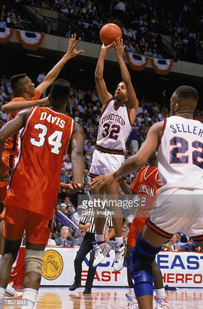 Tate George of the UConn Huskies puts up a shot during the 1990 sweet sixteen NCAA Tournament basketball game against Clemson at the Meadowlands on...
