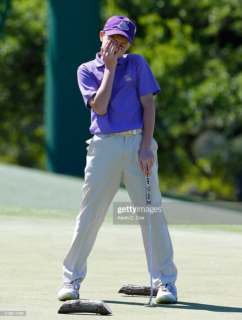 Tate Herrenbruck reacts after his second putt in the 12-13 Boys Drive, Chip and Putt Championship at Augusta National Golf Club on April 3, 2016 in Augusta, Georgia.