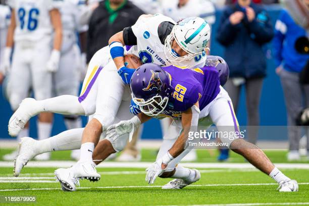 Tate Lehtio of West Florida makes a reception over Jack Leius of Minnesota State during the Division II Men's Football Championship held at McKinney...