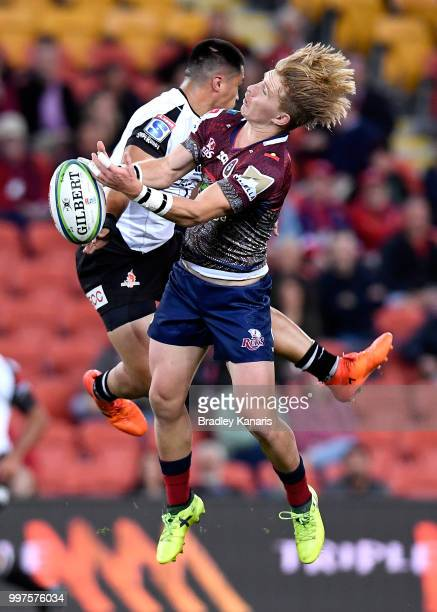 Tate McDermott of the Reds and Jason Emery of the Sunwolves compete for the ball during the round 19 Super Rugby match between the Reds and the...