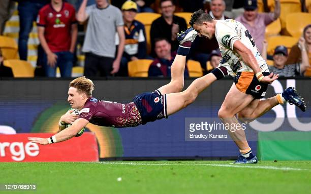 Tate McDermott of the Reds scores a try during the round 10 Super Rugby AU match between the Reds and the Brumbies at Suncorp Stadium on September...