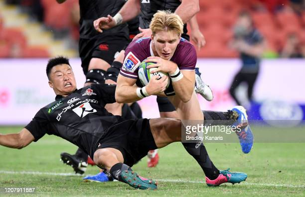 Tate McDermott of the Reds scores a try during the round four Super Rugby match between the Reds and the Sunwolves at Suncorp Stadium on February 22,...