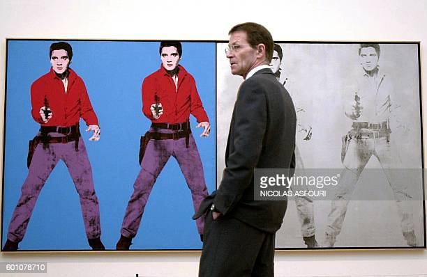 Tate Modern director Nicholas Serota standsin front of a work featuring Elvis Presely by the enigmatic American artist Andy Warhol at the Tate Modern...