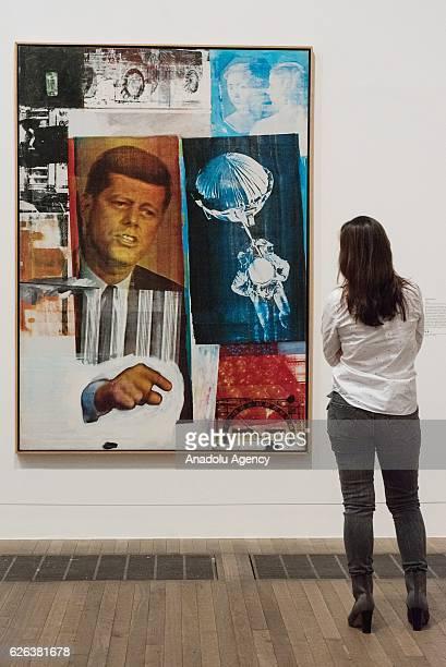 Tate Modern staff views artwork titled Retroactive II, dated 1963, by artist Robert Rauschenberg on November 28, 2016 in London, England. The Tate...