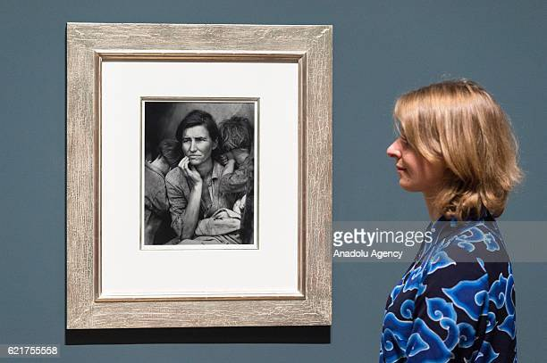 Tate Modern staff views photograph titled One of the Homeless Wandering Boys by photographer Dorothea Lange on November 08, 2016 in London, England....