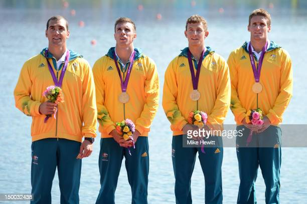 Tate Smith Dave Smith Murray Stewart and Jacob Clear of Australia celebrate winning the Gold medal during the medal ceremony for the Men's Kayak Four...