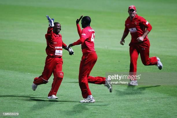 Tatenda Taibu celebrates with Elton Chigumbura of Zimbabwe after the dismissal of Nathan McCullum of New Zealand during the second International...