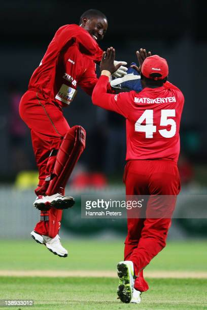 Tatenda Taibu celebrates with Stuart Matsikenyeri of Zimbabwe after running James Franklin out New Zealand during the second International Twenty20...