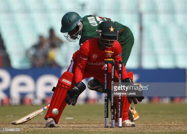 Tatenda Taibu of Zimbabwe celabrates as Collins Obuya of Kenya is run out by Vusi Sibanda of Zimbabwe during the ICC World Cup match between Kenya...
