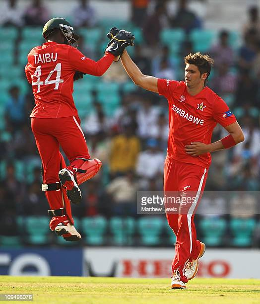 Tatenda Taibu of Zimbabwe celebrates the wicket of Balaji Rao of Canada with Graeme Cremer during the 2011 ICC World Cup Group A game between Canada...