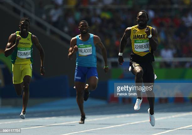 Tatenda Tsumba of Zimbabwe Rolando Palacios of Honduras and Nickel Ashmeade of Jamaica compete during the Men's 200m Round 1 Heat 6 on Day 11 of the...