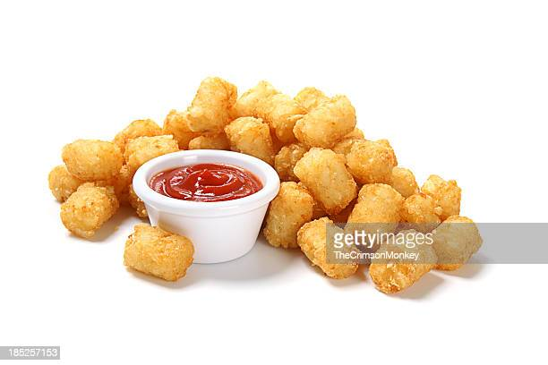 tater tots with ketchup - raw potato stock pictures, royalty-free photos & images