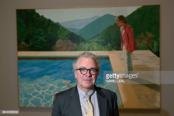 Tate's Head of Displays and Lead Curator Modern British Art Chris Stephens poses for a photograph in front of an artwork entitled 'Portrait of an...