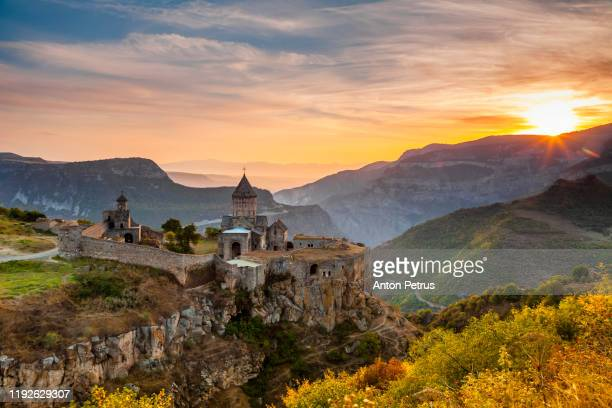 tatev monastery at sunrise in the mountains. tatev, armenia - armenia stock pictures, royalty-free photos & images