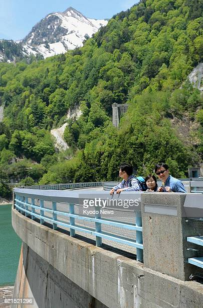 Tateyama Japan Tourists view Kurobe Dam on the Kurobe River in Toyama Prefecture on June 5 the 50th anniversary of the dam's completion