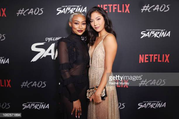 Tati Gabrielle and Adeline Rudolph attend Netflix Original Series Chilling Adventures of Sabrina red carpet and premiere event on October 19 2018 in...