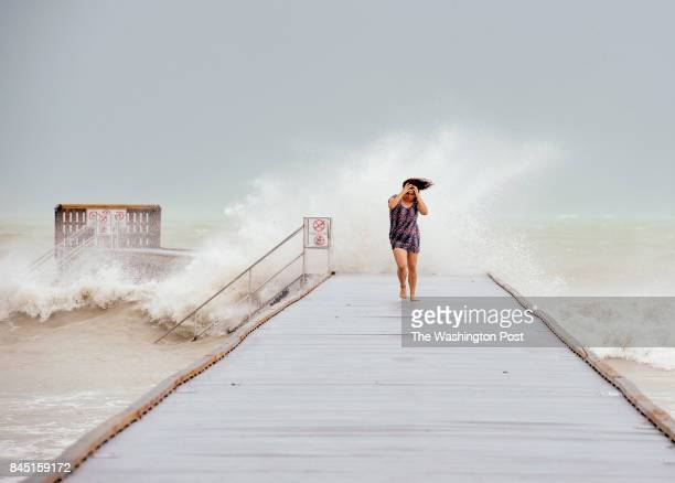 SEPTEMBER 9 2017 Tati Roberts of Key West Fla retreats from the Higgs Beach pier Saturday September 9 2017 Tropical storm force winds from Hurricane...