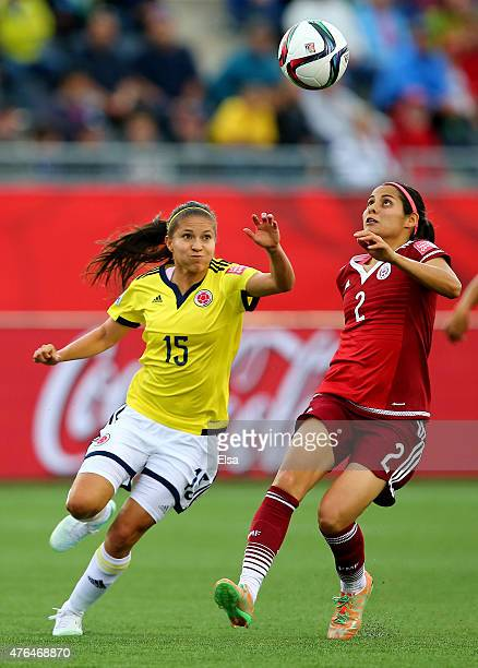 Tatiana Ariza of Colombia and Kenti Robles of Mexico chase the ball in the second half during the FIFA Women's World Cup 2015 Group F match at...