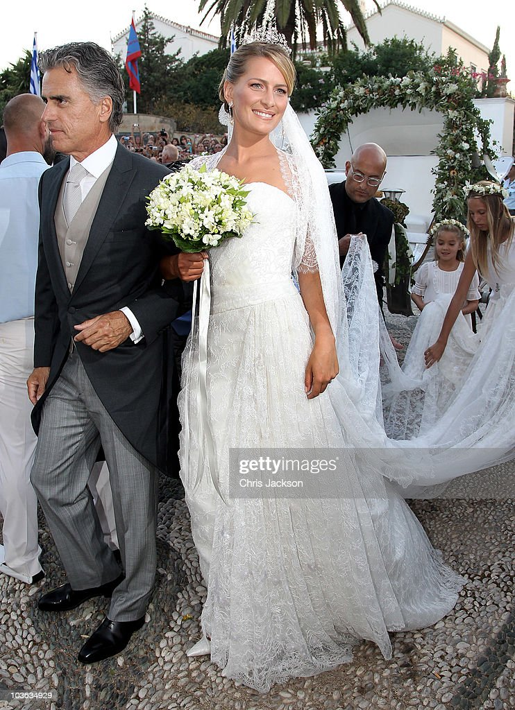Tatiana Blatnik and her father Atilio Brillembourg arrive at the Cathedral of Ayios Nikolaos (St. Nicholas) for her wedding to Prince Nikolaos of Greece on August 25, 2010 in Spetses, Greece. Representatives from Europe�s royal families will join the many guests who have travelled to the island to attend the wedding of Prince Nikolaos of Greece, the second son of King Constantine of Greece and Queen Anne-Marie of Greece and Tatiana Blatnik an events planner for Diane Von Furstenburg in London.