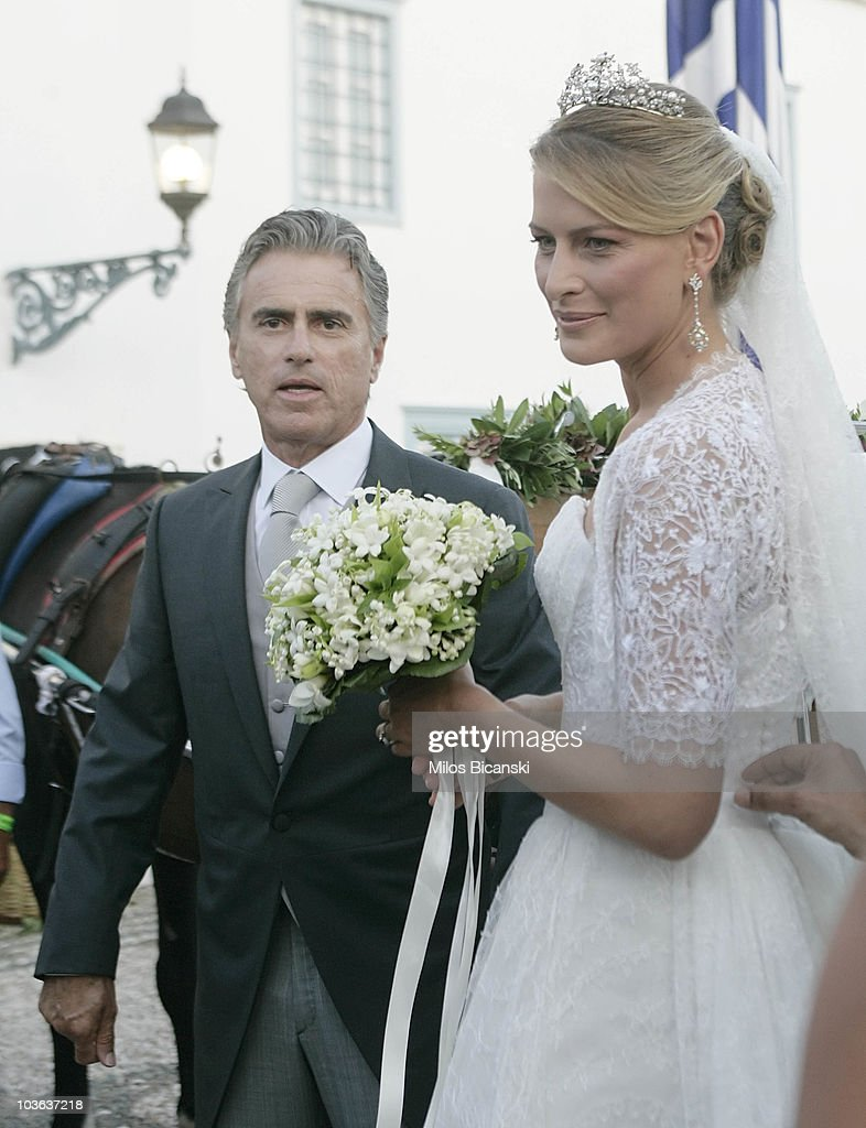 Tatiana Blatnik and her father Atilio Brillembourg (L) arrive at the Cathedral of Ayios Nikolaos (St. Nicholas) for her wedding to Prince Nikolaos of Greece on August 25, 2010 in Spetses, Greece. Representatives from Europe?s royal families will join the many guests who have travelled to the island to attend the wedding of Prince Nikolaos of Greece, the second son of King Constantine of Greece and Queen Anne-Marie of Greece and Tatiana Blatnik an events planner for Diane Von Furstenburg in London.