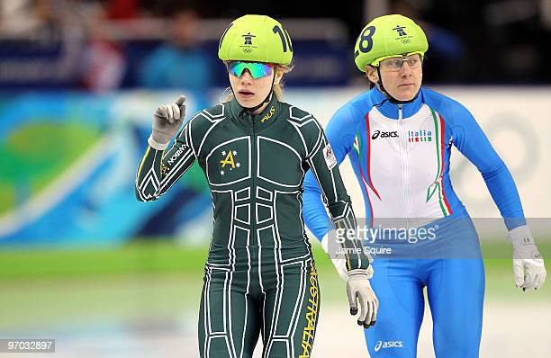 Tatiana Borodulina of Australia and Cecilia Maffei of Italy look on after competing in the Short Track Speed Skating Ladies 1000m heat on day 13 of...