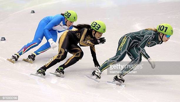 Tatiana Borodulina of Australia leads Mika Ozawa of Japan and Cecilia Maffei of Italy in the Short Track Speed Skating Ladies 1000m heat on day 13 of...