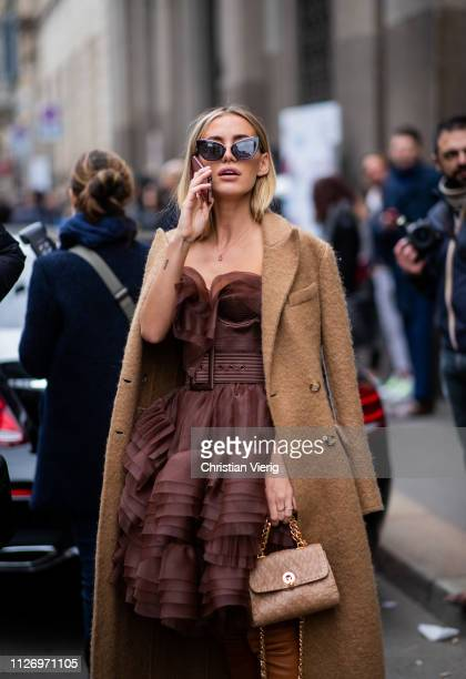 Tatiana Catic wearing beige coat dress attends the Ermanno Scervino show at Milan Fashion Week Autumn/Winter 2019/20 on February 23 2019 in Milan...