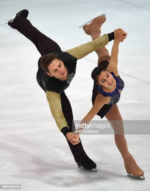 Tatiana Danilova and Mikalai Kamianchuk from Belarus perform during their pairs free skating program of the 49th Nebelhorn trophy figure skating...