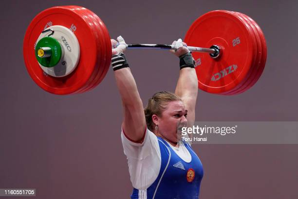 Tatiana Kashirina of Russia competes in the women's +87kg weightlifting on day two of the Ready Steady Tokyo - Weightlifting, Tokyo 2020 Olympic...
