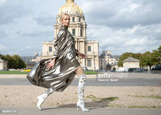 Tatiana Korsakova attends Nina Ricci Spring/Summer 2018 show wearing an Ellery dressBoots by Aquazzura and Earrings by Loewe during Paris Fashion...