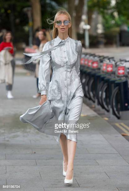 Tatiana Korsakova seen at the Christopher Kane SS18 wearing a Silver Gucci dressGucci shoes ans Saint Laurent sunglasses on Day 3 of London Fashion...