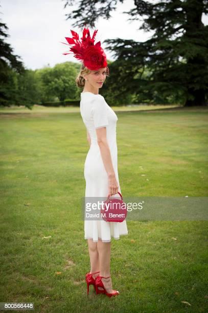 Tatiana Korsakova wearing aDolce Gabbana dress Arturo Rios Hat BUwood bag and Christian Louboutin shoes For Royal Ascot on June 24 2017 in...
