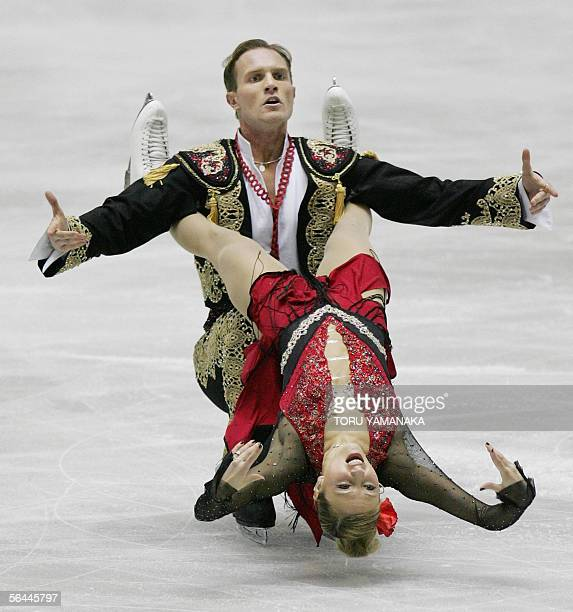 Tatiana Navka of Russia and her partner Roman Kostomarov perform during their free dance event in the figure skating Grand Prix series final in Tokyo...