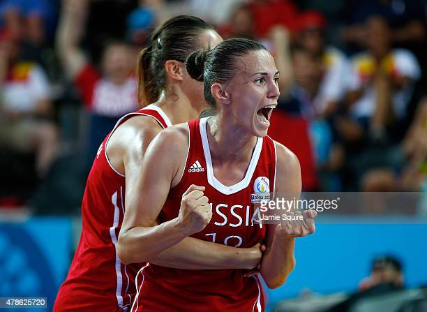 Tatiana Petrushina and Anna Leshkovtseva of Russia celebrate winning gold during the Women's 3x3 Basketball gold medal match on day fourteen of the...