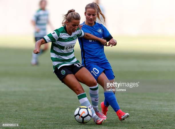 Tatiana Pinto of Sporting CP competes for the ball with Diana Csanyi of MTK Hungaria FC during the UEFA Women's Champions League Qualifying match...