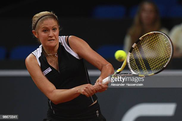 Tatiana Poutchek of Belarus plays a back hand during her qualification match against Julia Kimmelmann of Germany at day one of the WTA Porsche Tennis...