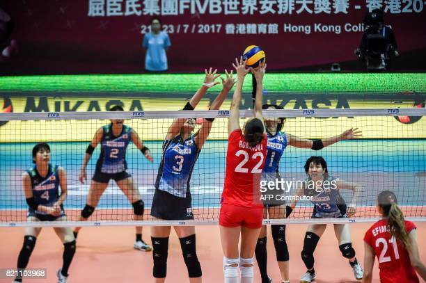 Tatiana Romanova of Russia and Yurie Nabeya of Japan compete for the ball during a match at the Women's Volleyball World Grand Prix in Hong Kong on...