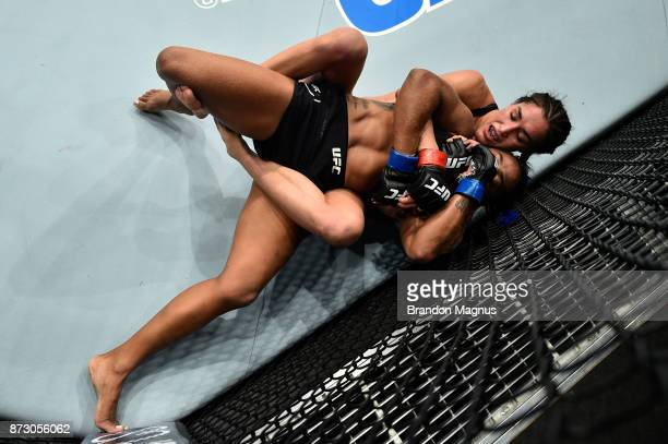 Tatiana Suarez attempts to submit Viviane Pereira of Brazil in their women's strawweight bout during the UFC Fight Night event inside the Ted...