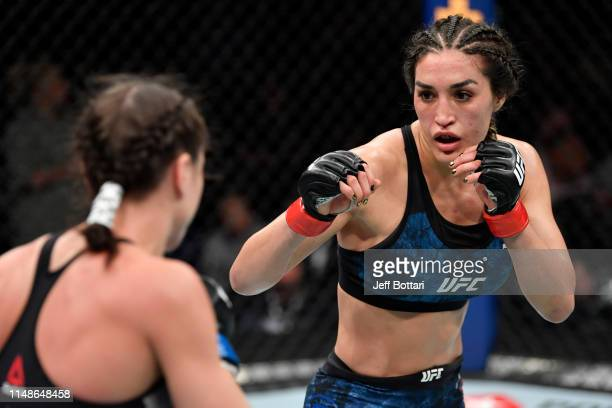 Tatiana Suarez battles Nina Ansaroff in their women's strawweight bout during the UFC 238 event at the United Center on June 8 2019 in Chicago...
