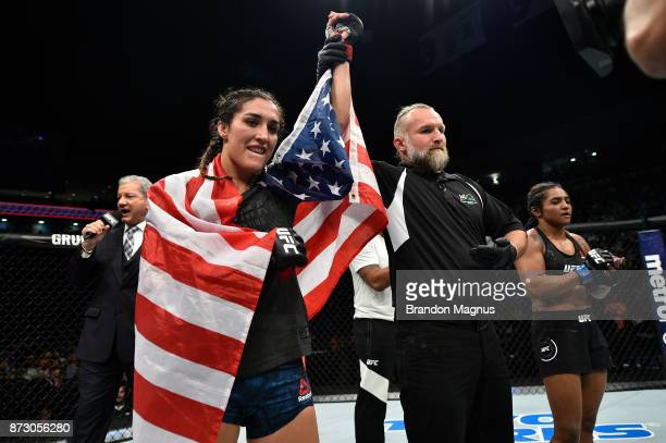 Tatiana Suarez celebrates after defeating Viviane Pereira of Brazil by unanimous decision in their women's strawweight bout during the UFC Fight...