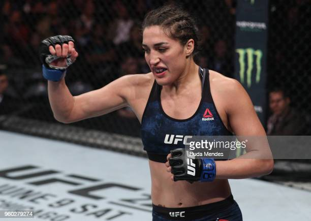 Tatiana Suarez celebrates after her submission victory over Alexa Grasso of Mexico in their women's strawweight bout during the UFC Fight Night event...