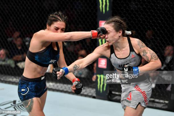 Tatiana Suarez punches Nina Ansaroff in their women's strawweight bout during the UFC 238 event at the United Center on June 8 2019 in Chicago...